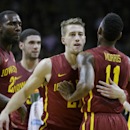 Iowa State guard Matt Thomas, center, celebrates with teammate Monte Morris (11) after making a 3-pointer at the end of the first half of an NCAA college basketball game against Iowa, Friday, Dec. 12, 2014, in Iowa City, Iowa.(AP Photo/Charlie Neibergall)