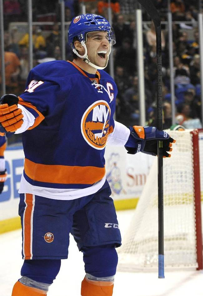 New York Islanders' John Tavares (91) and Kyle Okposo (21) celebrate Tavares' goal against Boston Bruins goalie Chad Johnson (30) in the second period of an NHL hockey game at the Nassau Coliseum on Saturday, Nov. 2, 2013, in Uniondale, N.Y