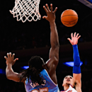 NEW YORK, NY - NOVEMBER 16: Shane Larkin #0 of the New York Knicks shoots over Kenneth Faried #35 of the Denver Nuggets in the second half at Madison Square Garden on November 16, 2014 in New York City. (Photo by Alex Goodlett/Getty Images)