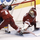Arizona Coyotes' Mike Smith (41) makes a save on a shot by St. Louis Blues' Joakim Lindstrom, of Sweden, as Coyotes' Zbynek Michalek (4), of the Czech Republic, defends during the first period of an NHL hockey game Saturday, Oct. 18, 2014, in Glendale, Ar