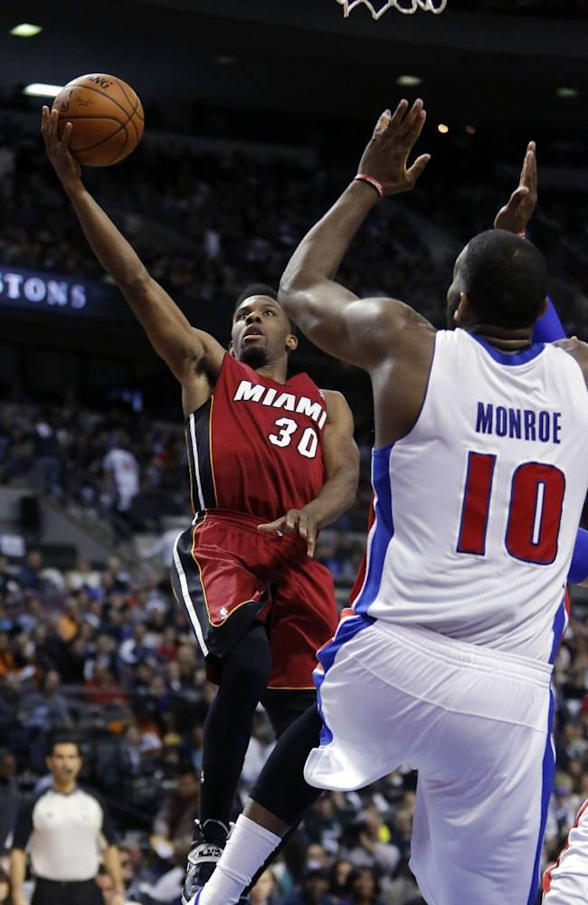 Miami Heat guard Norris Cole (30) shoots against Detroit Pistons center Greg Monroe (10) during the second half of an NBA basketball game on Friday, March 28, 2014, in Auburn Hills, Mich. The Heat defeated the Pistons 110-78
