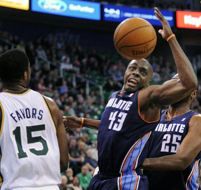 Charlotte Bobcats' Anthony Tolliver (43) loses the ball in-between the Utah Jazz's  Derrick Favors (15) and Bobcats' Al Jefferson (25) in the first quarter of an NBA basketball game Monday, Dec. 30, 2013, in Salt Lake City