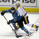 San Jose Sharks' Marc-Edouard Vlasic (44) collides with Nashville Predators' Colin Wilson (33) during the third period of an NHL hockey game on Saturday, April 5, 2014, in San Jose, Calif. Nashville won 3-0 The Associated Press