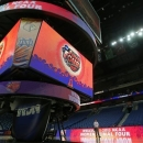 Workers continue preparations at the New Orleans Arena in New Orleans, Friday, April 5, 2013. The Women's Final Four of the NCAA College Basketball tournament will be held at the arena this weekend. (AP Photo/Dave Martin)