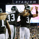 Philadelphia Eagles quarterback Mark Sanchez (3) celebrates his touchdown pass to wide receiver Damaris Johnson (13) during the second half of an NFL preseason football game against the New England Patriots on Friday, Aug. 15, 2014, in Foxborough, Mass Th