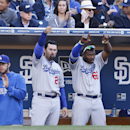 Los Angeles Dodgers' Clayton Kershaw, left, Adrian Gonzalez, center, and Yasiel Puig react toward teammate Dee Gordon after Gordon drove in a run against the San Diego Padres in the fourth inning of a baseball game Tuesday, April 1, 2014, in San Diego Th