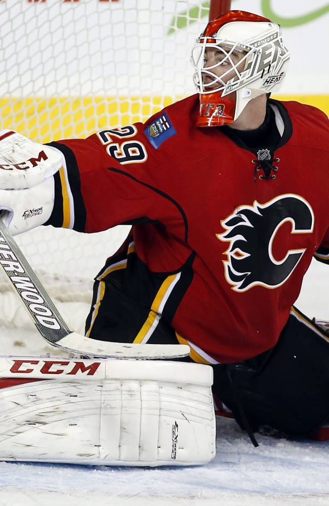Calgary Flames goalie Reto Berra, from Switzerland, lets in the game-winning overtime goal during an NHL preseason hockey game against the Phoenix Coyotes, Wednesday, Sept. 25, 2013, in Calgary, Alberta. The Coyotes won 3-2