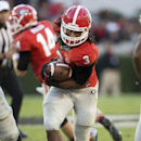 Georgia running back Todd Gurley (3) breaks through the Vanderbilt line in the second half of an NCAA college football game Saturday, Oct. 4, 2014, in Athens, Ga.. Georgia won 44-17 The Associated Press