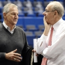 FILE - In this Feb. 13, 2013, file photo, Former Connecticut head coach Jim Calhoun, left, speaks with Syracuse head coach Jim Boeheim before an NCAA college basketball game between the two teams in Hartford, Conn. Hall of Fame coaches John Thompson and Jim Calhoun say behavior like that caught on video of fired Rutgers coach Mike Rice isn't appropriate, and never was. (AP Photo/Jessica Hill, File)