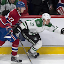 Dallas Stars' Travis Moen breaks away from Montreal Canadiens' Dale Weise during the first period of an NHL hockey game Tuesday, Jan. 27, 2015, in Montreal The Associated Press