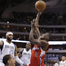 Los Angeles Clippers guard Darren Collison (2) knocks Dallas Mavericks guard Devin Harris (20) off his feet and is called for an offensive foul during the first half of an NBA basketball game Thursday, March 27, 2014, in Dallas The Associated Press