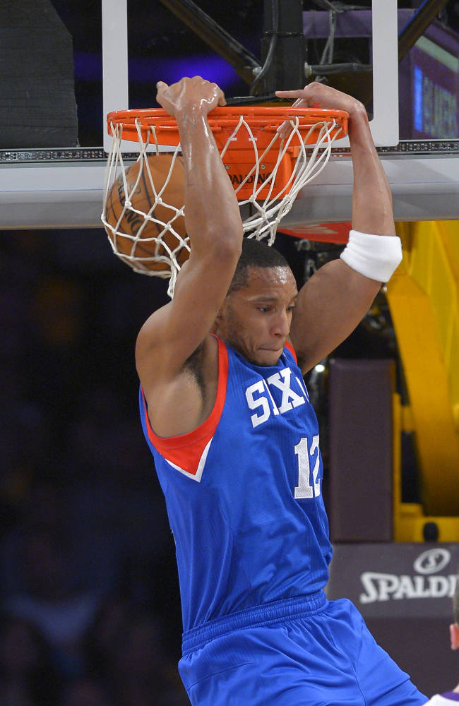 Philadelphia 76ers forward Evan Turner dunks during the first half of an NBA basketball game against the Los Angeles Lakers, Sunday, Dec. 29, 2013, in Los Angeles