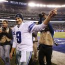 Dallas Cowboys quarterback Tony Romo (9) waves to fans as he walks off the field after the Cowboys beat the New York Giants 31-28 in an NFL football game, Sunday, Nov. 23, 2014, in East Rutherford, N.J. (AP Photo/Kathy Willens)