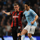 West Bromwich Albion's Chris Brunt, left, tackles Manchester City's Samir Nasri during the English Premier League soccer match at the Etihad Stadium, Manchester, England, Monday April 21, 2014