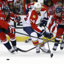 Washington Capitals left wing Jason Chimera (25), Florida Panthers right wing Brad Boyes (24) and Capitals right wing Eric Fehr (16) go for the puck in the second period of an NHL hockey game, Saturday, Oct. 18, 2014, in Washington The Associated Press