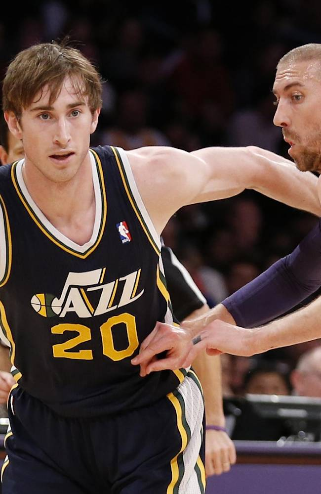 Utah Jazz's Gordon Hayward, left, drives past Los Angeles Lakers' Steve Blake during the first half of an NBA basketball game in Los Angeles, Tuesday, Feb. 11, 2014
