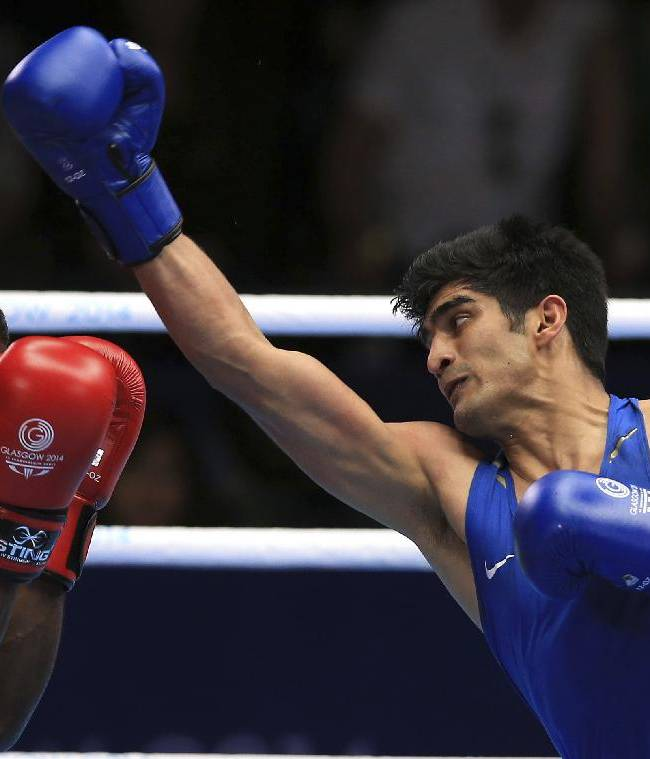 India's Vijender Vijender, right, fights Trinidad and Tobago's Aaron Prince in the Men's middle weight quarterfinal during the 2014 Commonwealth Games in Glasgow, Scotland, Wednesday July 30, 2014