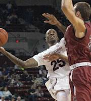Mississippi State's Roquez Johnson (25) shoots around South Carolina's Mindaugas Kacinas, right, during the first half of an NCAA college basketball game in Starkville, Miss., Saturday, March 8, 2014. (AP Photo/Jim Lytle)
