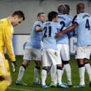 Manchester City's scorer James Milner, second left, celebrates his side's 2nd goal with his teammates during the Group E Champions League soccer match between CSKA Moscow and Manchester City at Arena Khimki stadium in Moscow, Russia, Tuesday, Oct. 21, 201