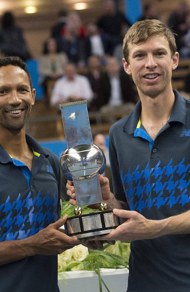 South Africa's Raven Klaasen, left, and Eric Butorac of the US celebrate with the trophy after winning the Stockholm Open men's doubles tennis final against Treat Huey, of the Philippines, and Jack Sock, of the U.S.  on Sunday Oct. 19, 2014. (AP Photo / Jonas Ekstromer)