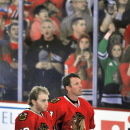 In this photo taken on Sept. 22, 2014, Chicago Blackhawks' Brad Richards, right, stands on the ice with teammate Patrick Kane before the team's hockey training camp festival in Chicago. Richards is on a long list of accomplished forwards getting used to n