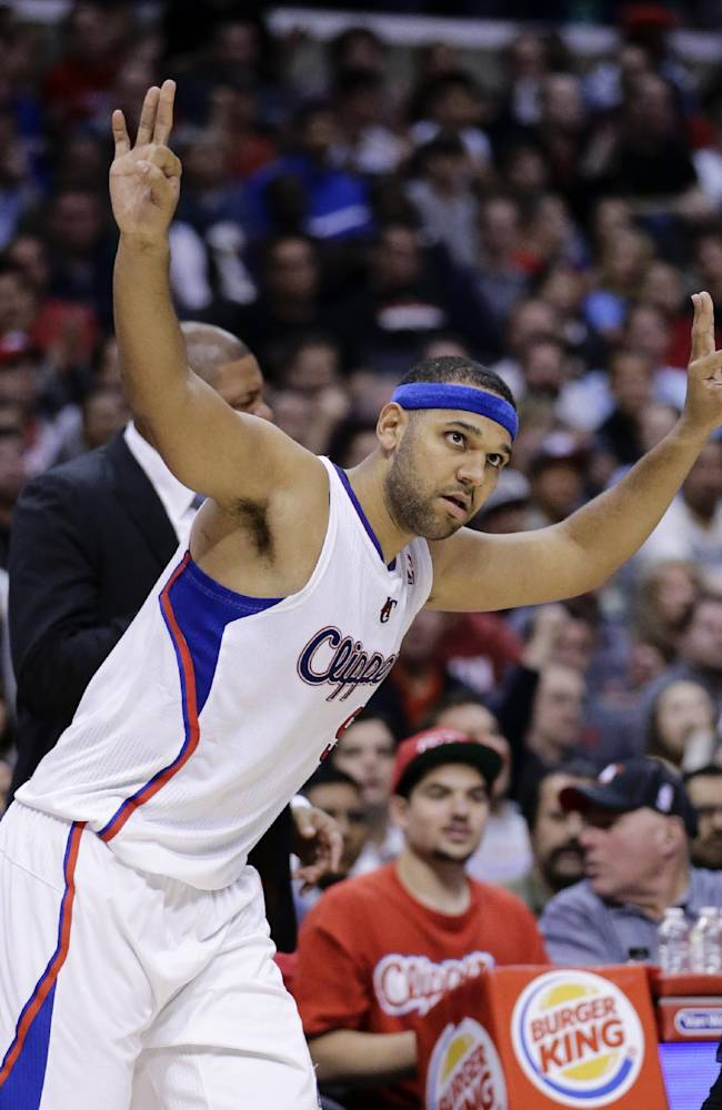 Los Angeles Clippers' Jared Dudley reacts to his 3-point basket during the second half of an NBA basketball game against the New Orleans Pelicans on Wednesday, Dec. 18, 2013, in Los Angeles. The Clippers won 108-95