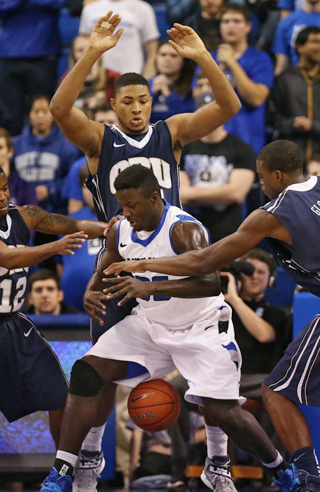 St. Louis University forward Reggie Agbeko loses the ball as he is swarmed by Oral Roberts players including, from left, D.J. Jackson, Denell Henderson and Shawn Glover in the first half of an NCAA college basketball game, Thursday, Nov. 21, 2013 in St. Louis