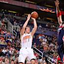 PHOENIX, AZ - JANUARY 28: Goran Dragic #1 of the Phoenix Suns takes a shot against the Washington Wizards on January 28, 2015 at U.S. Airways Center in Phoenix, Arizona. (Photo by Barry Gossage/NBAE via Getty Images)