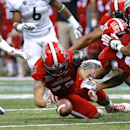 Louisiana-Lafayette defensive end Dominique Tovell, center, recovers a fumble during the first half of the New Orleans Bowl NCAA college football game against Nevada in New Orleans, Saturday, Dec. 20, 2014 The Associated Press