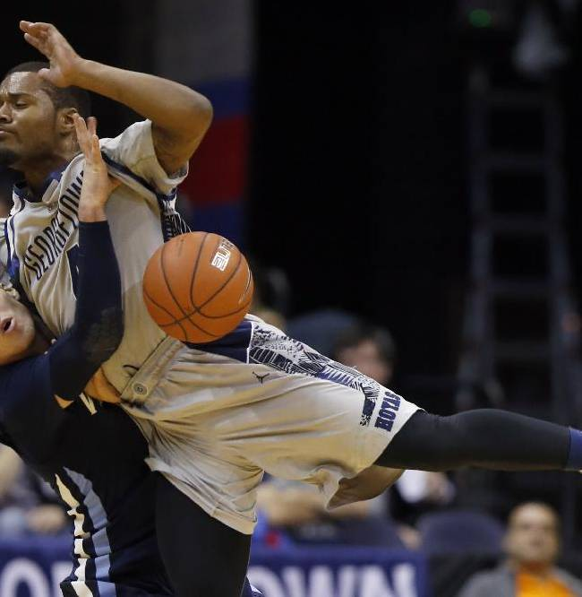Georgetown guard D'Vauntes Smith-Rivera, right collides with Villanova guard Ryan Arcidiacono (15) after he attempted to shoot, during the second half of an NCAA college basketball game, Monday, Jan. 27, 2014, in Washington. Villanova won 65-60