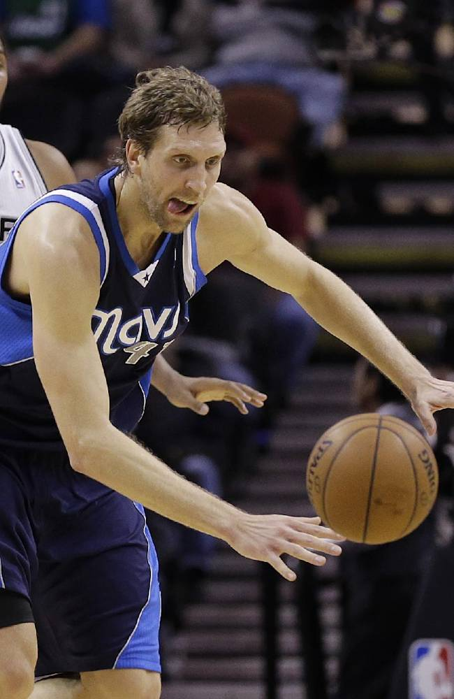 Dallas Mavericks' Dirk Nowitzki chases a loose ball during the first half on an NBA basketball game against the San Antonio Spurs, Wednesday, Jan. 8, 2014, in San Antonio. San Antonio won 112-90