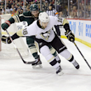 Pittsburgh Penguins center Brandon Sutter (16) controls the puck in front of Minnesota Wild defenseman Marco Scandella (6) during the second period of an NHL hockey game in St. Paul, Minn., Saturday, April 5, 2014 The Associated Press