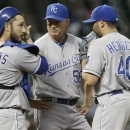 Kansas City Royals pitching coach Dave Eiland (58) talks with catcher George Kottaras (26) and relief pitcher Kelvin Herrera in the eighth inning of a baseball game against the Houston Astros, Wednesday, May 22, 2013, in Houston. The Astros won 3-1. (AP Photo/Pat Sullivan)