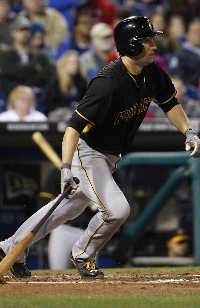 Pittsburgh Pirates' Neil Walker heads to first on a single during the fourth inning of the Pirates' exhibition baseball game against the Philadelphia Phillies, Friday, March 28, 2014, in Philadelphia. The Pirates won 3-0