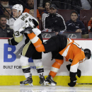 Philadelphia Flyers' Brayden Schenn, right, collides with Pittsburgh Penguins' Nick Spaling during the third period of an NHL hockey game, Tuesday, Jan. 20, 2015, in Philadelphia. Philadelphia won 3-2 in overtime The Associated Press