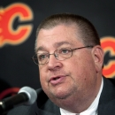 Flames fire general manager Jay Feaster, assistant The Associated Press