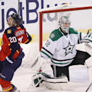 Florida Panthers left wing Sean Bergenheim (20) reacts after his game-winning goal as Dallas Stars goalie Kari Lehtonen (32) looks on during the third period of an NHL hockey game in Sunrise, Fla., Sunday, April 6, 2014 The Associated Press