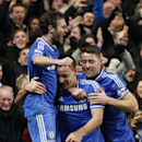 Chelsea s Juan Mata, left, of Spain, and Gary Cahill, right, celebrate with their captain John Terry after he scored against Southampton, during their English Premier League soccer match at the Stamford bridge ground in London, Sunday, Dec. 1, 2013. Chels