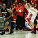 San Diego State's Xavier Thames (2) runs a play while guarded by New Mexico's Hugh Greenwood (3) during the second half of an NCAA college basketball game at The Pit in Albuquerque, N.M., Saturday, Feb. 22, 2014. New Mexico won the game 58-44 The Associat