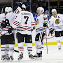 Chicago Blackhawks' Patrick Kane (88) celebrates a goal with teammates Brent Seabrook (7), Patrick Kane (88) and Patrick Sharp (10) during the second period of an NHL preseason hockey game against the New York Rangers, Friday, Oct. 3, 2014, in New York Th