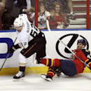 After knocking Florida Panthers' Mike Weaver (43) to the ice, Anaheim Ducks' Patrick Maroon (62) chases the puck during the first period of an NHL hockey game in Sunrise, Fla., Tuesday, Nov. 12, 2013 The Associated Press