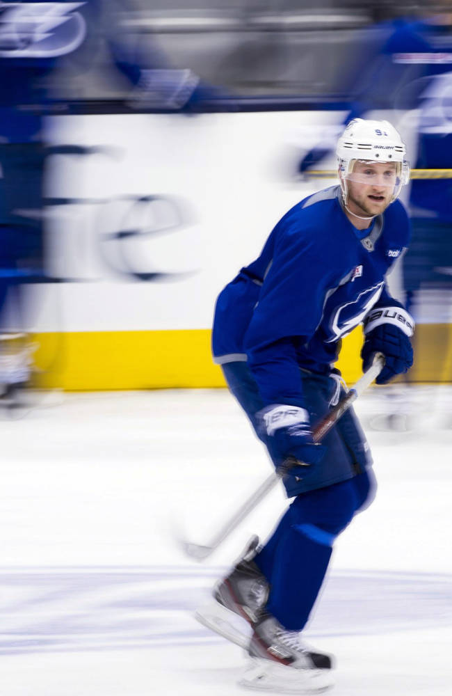 Tampa Bay Lightning forward Steven Stamkos skates during NHL hockey practice in Toronto on Tuesday, Jan. 28, 2014. Stamkos, who broke his leg in November, hopes that he will be able to play with the Lightning and then participate in the Sochi winter Olympic games next month for Canada