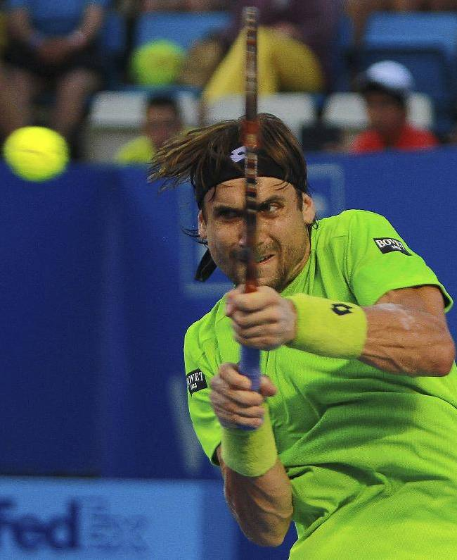 Spain's David Ferrer returns the ball to Spain's Feliciano Lopez at the Mexican Tennis Open in Acapulco, Mexico, Wednesday Feb. 26, 2014
