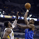 Dallas Mavericks center Samuel Dalembert, right, shoots over Indiana Pacers center Roy Hibbert during the first half of an NBA basketball game in Indianapolis, Wednesday, Feb. 12, 2014 The Associated Press