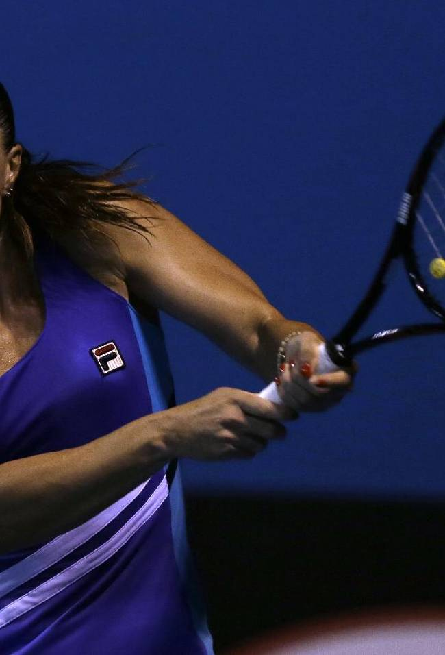 Jelena Jankovic of Serbia  makes a backhand return to Ayumi Morita of Japan during their second round match against at the Australian Open tennis championship in Melbourne, Australia, Thursday, Jan. 16, 2014