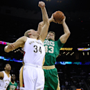 Boston Celtics center Kris Humphries (43) and New Orleans Pelicans center Greg Stiemsma (34) go for a rebound during the first half of an NBA basketball game in New Orleans, Sunday, March 16, 2014 The Associated Press