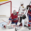Montreal Canadiens goaltender Carey Price makes a save against Chicago Blackhawks' Jonathan Toews during the second period of an NHL hockey game, Tuesday, Nov. 4, 2014 in Montreal The Associated Press