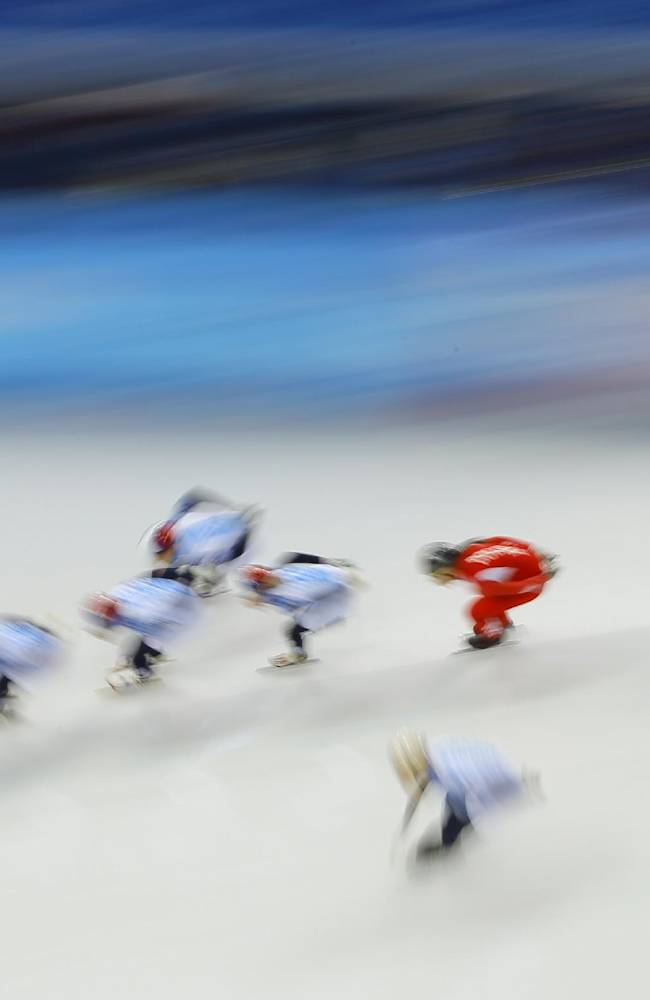 Patrycja Maliszewska of Poland, in red, trains with Russian skaters during a short track speedskating practice session at the Iceberg Skating Palace ahead of the 2014 Winter Olympics, Thursday, Feb. 6, 2014, in Sochi, Russia