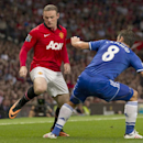 Manchester United's Wayne Rooney, left, fights for the ball against Chelsea's Frank Lampard during their English Premier League soccer match at Old Trafford Stadium, Manchester, England, Monday Aug. 26, 2013. (AP Photo/Jon Super)