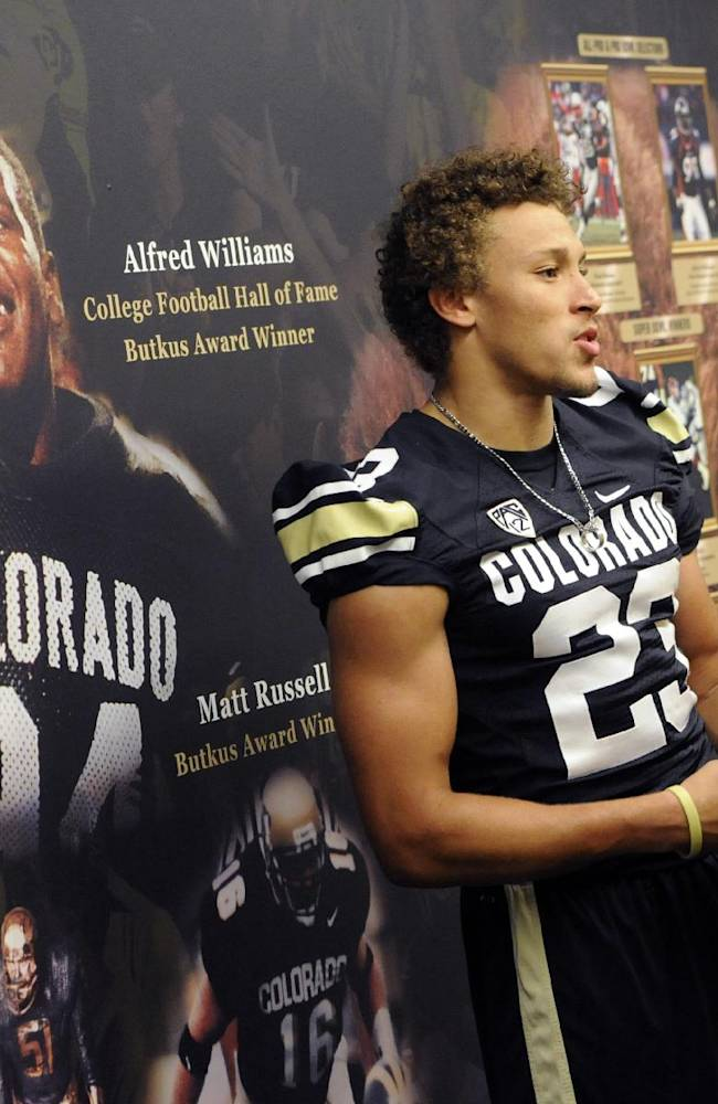Colorado running back Phillip Lindsay talks to reporters during NCAA college football media day on Saturday, Aug. 9, 2014, in Boulder, Colo